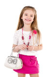 Happy cute little girl in skirt with bag and beads Stock Images