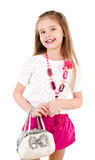 Happy cute little girl in skirt with bag and beads Royalty Free Stock Images