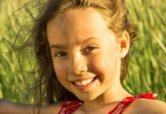 Happy cute little girl smiling at sunset Stock Photography