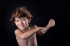 Happy cute little kid having fun with flying hair Royalty Free Stock Photos