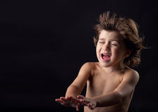 Happy cute little kid having fun with flying hair Stock Images