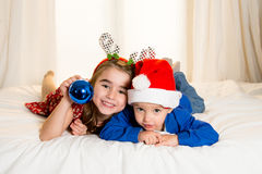 Happy cute little kid and his sister at christmas royalty free stock image