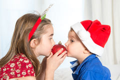 Happy cute little kid and his sister at christmas Royalty Free Stock Images