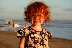 Happy Cute little redhead girl on the Bali beach. Sunset Royalty Free Stock Photography