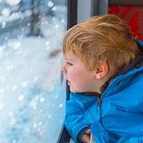 Cute little toddler boy looking out train window Royalty Free Stock Images