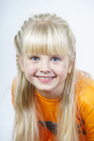 Happy cute little towhead girl royalty free stock photography