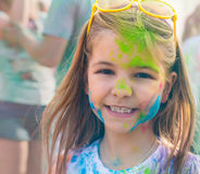 Happy cute litttle girl on holi color festival Royalty Free Stock Photography