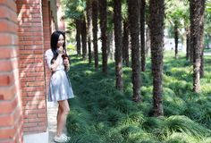 Happy cute lovely beautiful young girl high school college student drink cola at classroom porch royalty free stock photo