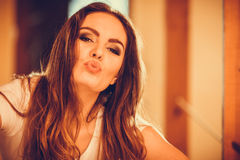 Happy cute pretty young woman girl blowing kiss. Royalty Free Stock Photo