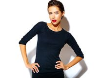 Happy cute sexy brunette woman in casual black dress with red lips Stock Photos