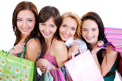 Happy cute smiling adult girls with shopping bags royalty free stock image
