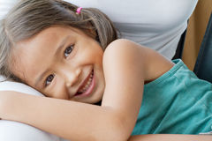 Happy, cute, smiling female child, daughter playing on her mothe Royalty Free Stock Photography