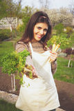 Happy cute woman giving fresh vegetables Royalty Free Stock Photo