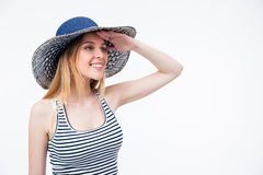 Happy cute woman in hat looking into distance Stock Photography
