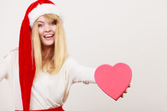 Happy cute woman with heart shape box. Christmas. Stock Photography