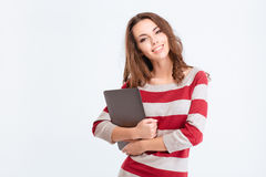 Happy cute woman holding laptop computer. Portrait of a happy cute woman holding laptop computer isolated on a white background and looking at camera Royalty Free Stock Photos