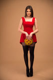 Happy cute woman in red dress Royalty Free Stock Image