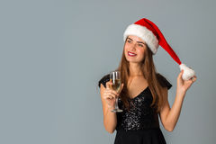 Happy cute woman in santa hat Royalty Free Stock Photos