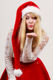 Happy cute woman in santa helper hat. Christmas. Stock Photography