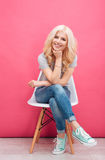 Happy cute woman sitting on the chair Royalty Free Stock Image