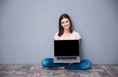 Happy cute woman sitting on the floor Royalty Free Stock Photo