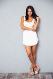 Happy cute woman in trendy white dress Stock Photography