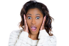 A happy cute young woman looking shocked, hands on cheek Royalty Free Stock Photo