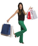 Happy cute young woman shopping with color bags - isolated. Royalty Free Stock Photography