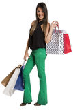 Happy cute young woman shopping with color bags - isolated. Stock Photos