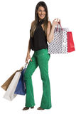 Happy cute young woman shopping with color bags - isolated. Royalty Free Stock Photo