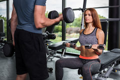 Happy cutie athletic girl , execute exercise with dumb-bells Stock Images