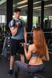 Happy cutie athletic girl , execute exercise with dumb-bells Stock Photography
