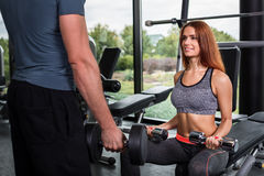 Happy cutie athletic girl , execute exercise with dumb-bells Royalty Free Stock Image