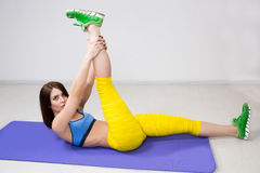 Happy cutie athletic girl ,  execute exercise on Stock Photos