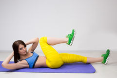 Happy cutie athletic girl ,  execute exercise on Royalty Free Stock Images