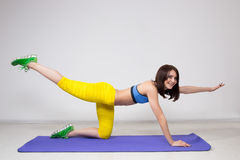 Happy cutie athletic girl ,  execute exercise on Stock Images