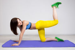 Happy cutie athletic girl ,  execute exercise on Royalty Free Stock Photography