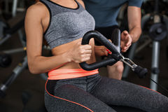 Happy cutie athletic girl , execute exercise in sport-hall Stock Photo