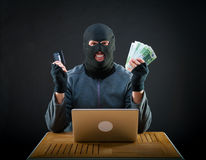 Happy cybercriminal man holding euro cash Royalty Free Stock Photos