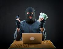 Happy cybercriminal man holding euro cash Royalty Free Stock Photos