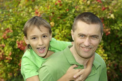 Happy Dad And Kid Playing Royalty Free Stock Photos