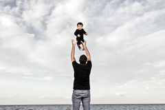 Happy dad with baby at the beach Stock Photo