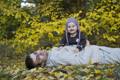 Happy dad and baby girl. Portrait with dad and daughter having fun in the park Stock Images
