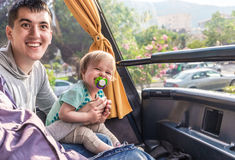Happy dad with baby ride on double decker bus Royalty Free Stock Photo