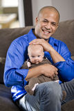 Happy dad with baby sitting on lap. Happy dad with 3 month old baby sitting on lap Royalty Free Stock Photos