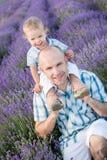 Happy dad with baby son in lavender Stock Photos