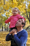 Happy dad and daughter. Portrait with dad and daughter having fun in the park Stock Photos