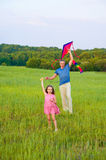 Happy dad and daughter in fild. Stock Photo