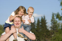 Happy Dad And Daughters Outdoors. Royalty Free Stock Photos