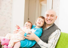 Happy dad with daughters Stock Photos